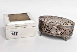 A GEORGE V SILVER LINED, SQUARE CIGARETTE BOX AND A PIERCED OVAL VANITY BOX, engine turned design
