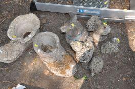 SEVEN COMPOSITE GARDEN FIGURES including two boot planters, a pig, a gnome etc