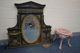 A DISTRESSED CAST IRON OVERMANTEL MIRROR, overpainted gilt and black, oval mirror, 120cm x 100cm (