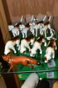 TWO SETS OF FOUR BESWICK FOXHOUNDS, first editions No 941 (x2) (one with reglued leg), No 942 (