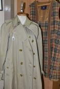 A LADIES BURBERRY TRENCH COAT, with detachable wool lining, approximate size 16/18 (staining to