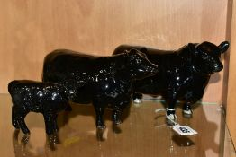 BESWICK ABERDEEN ANGUS CATTLE, comprising Bull No.1562, Cow No.1563 and Aberdeen Angus Calf No.