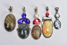 FIVE WHITE METAL GEM SET PENDANTS, large pendants set with a variety of semi-precious stones such as