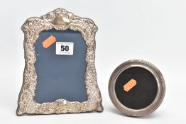 TWO SILVER PHOTOFRAMES, the first of a wavy rectangular form, embossed floral and foliate design