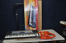 A FLYMO EASICUT 450 ELECTRIC HEDGE TRIMMER and a Casio CTK 471 electronic keyboard with box, power