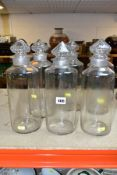 SIX HAND BLOWN GLASS STORAGE BOTTLES WITH CUT GLASS STOPPERS, height approximately 32cm, bottles are