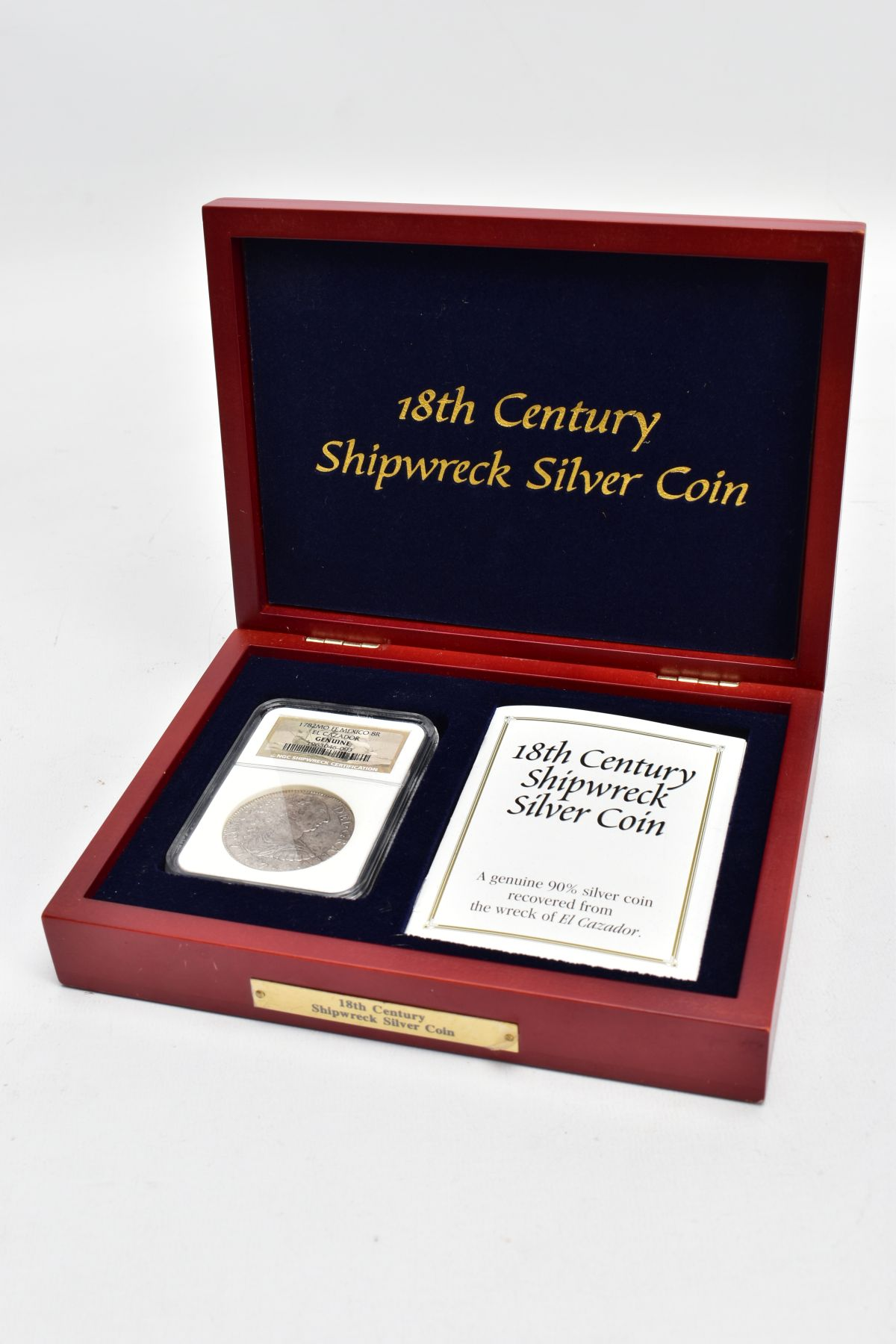 A SLABBED NGC SHIPWRECK CERTIFICATION OF A 18TH CENTURY 1782 SILVER EIGHT REALES COIN with