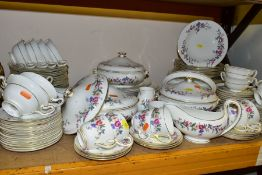A WEDGWOOD BONE CHINA 'DEVON SPRAYS' PATTERN DINNER SERVICE, comprising five graduated oval meat