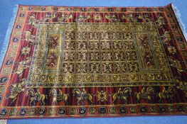A LAHORE RED AND GOLD GROUND RUG, 198cm x 134cm