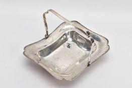 A GEORGE V SILVER BASKET, of a rectangular form, wavy rim, engraved floral and foliate design,