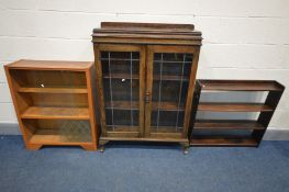 AN EARLY 20TH CENTURY OAK BOOKCASE, raised back, lead glazed effect doors enclosing two adjustable