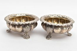 TWO SILVER BONBON DISHES, each with an embossed bowl, worn gilt interior, flower detailed rims, each