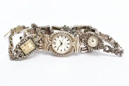 THREE LADIES WRISTWATCHES, the first a silver marcasite watch with a round cream dial, Arabic