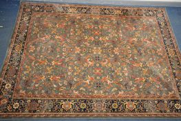 A LARGE WOOLLEN TABRIZ STYLE CARPET SQUARE, 346cm x 250cm and a pink tekke rug and a red rug (3)