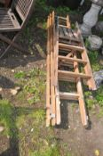 A SET OF WOODEN TRIPLE EXTENSION LADDERS 183cm long sections, and an earlier wooden step ladder (2)