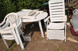 A WHITE PLASTIC GARDEN TABLE 140cm long , three chairs and a pair of loungers (6)