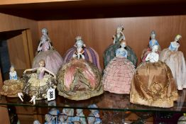 ELEVEN LATE 19TH/EARLY 20TH CENTURY PORCELAIN HALF-DOLL TEA COSIES, PIN CUSHIONS, HAT PINS CUSHIONS,