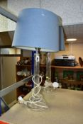 A PAIR OF LAURA ASHLEY CUT GLASS TABLE LAMPS, fitted with blue Laura Ashley lamp shades, height