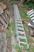 A SET OF ALUMINIUM DOUBLE EXTENSION LADDERS one section is 4m long with 15 rungs the other is 4.