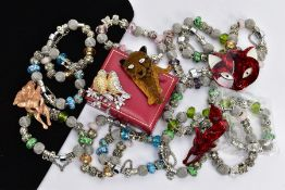 A BOX OF ASSORTED WHITE METAL CHARM BRACELETS AND BROOCHES, to include thirteen white metal charm