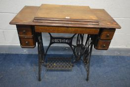 A SINGER TREDLE SEWING MACHINE