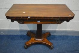 A VICTORIAN ROSEWOOD CARD TABLE, the fold over top enclosing a green baized playing surface, on a