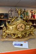 A LATE 19TH CENTURY FRENCH STYLE GILT METAL MANTLE CLOCK, the hand painted dial has a river