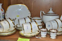 A COALPORT 'ELITE-GOLD' PATTERN TEA SET, comprising tea pot (second), milk jug, twin handled sugar