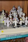 A COLLECTION OF FOURTEEN LATE 19TH/EARLY 20TH CENTURY PORCELAIN NUDE HALF-DOLLS, in a variety of