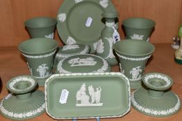 ELEVEN PIECES OF WEDGWOOD GREEN JASPERWARE, including a pair of dwarf candlesticks, two pairs of