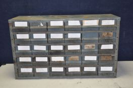 AN INDUSTRIAL METAL WORKSHOP DRAWER UNIT with thirty plastic 'Well construct' drawers , width 90cm