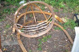A MODERN BENTWOOD GARDEN CORACLE CHAIR ON STAND , seat is 118cm in diameter semi hemispherical in