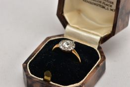 A YELLOW METAL DIAMOND CLUSTER, of a flower form, designed with a central old cut diamond within a