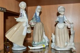 THREE NAO (LLADRO) FIGURES, comprising 'Graceful' 0237, girl with basket of fruit, height 24cm, girl