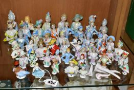 A COLLECTION OF OVER FORTY FIVE LATE 19TH/EARLY 20TH CENTURY PORCELAIN HALF DOLLS AND THREE LADIES