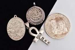 TWO SILVER PENDANTS, A WHITE METAL PENDANT AND A COMMEMORATIVE COIN, the first silver pendant in the