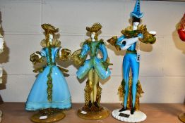 A PAIR OF BLUE AND YELLOW GLASS FIGURES OF A LADY AND GENTLEMAN in the style of the Venetian Glass
