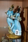 A MURANO GLASS FIGURE GROUP OF A LADY AND GENTLEMAN DANCING, blue and white costume with clear and