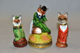 A ROYALE STRATFORD FOX BONBONNIERE AND TWO SIMILAR SCENT BOTTLES, all three modelled as seated foxes