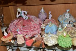 A COLLECTION OF SIXTEEN LATE/EARLY 20TH CENTURY PORCELAIN HALF-DOLLS, including two dressing table