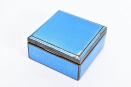 A 1930'S SILVER GUILLOCHE ENAMEL TRINKET BOX, the square hinged silver box covered in blue guilloche