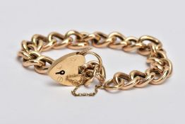 A 9CT GOLD CURB LINK BRACLET, with a heart padlock clasp and safety chain, 9ct hallmark for