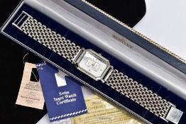 A PLATINUM INGOT WRISTWATCH, designed with a rectangular dial with cut off corners, set to the