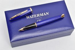 A BOXED WATERMAN CARENE FOUNTAIN PEN, gloss blue body and gold trim detail, 18k gold nib, together