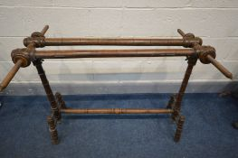 A VICTORIAN MAHOGANY EMBROIDERY FRAME, on a turned base, width 102cm x height 81cm