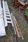 A VINTAGE WOODEN STEP LADDER height 141cm and a wooden triple extension ladder with eleven rungs