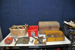 A VINTAGE TIN TRUNK 53cm wide 33cm deep 30cm high, a canted wooden toolbox sign written Ransomes,