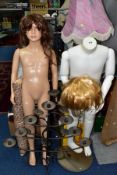 TWO PLASTIC CHILD SIZE MANNEQUINS ON STANDS, one in white with jointed parts, no head, the other a