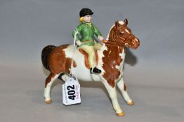 A BESWICK GIRL ON PONY, No 1499, skewbald, Beswick crest backstamp, height 14cm (Condition:- paint