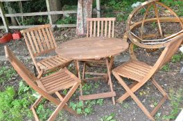 A MODERN HARDWOOD FOLDING GARDEN TABLE 90cm in diameter with four folding chairs (5)
